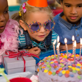 Celebrations: kids looking at birthday cake during party