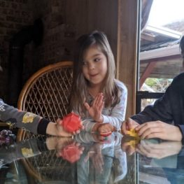 3 kids playing at kitchen table