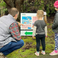 PopUp StoryWalk: Follow the trail to find the next page of a children's book.
