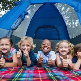 campgrounds: happy kids in a tent
