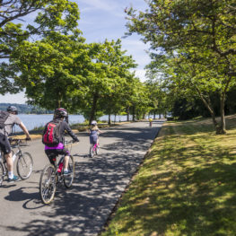 Cyclists on Lake Washington Boulevard a new way to play in Seattle Parks this weeknd