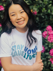 Madison Chan wearing one of her shirts.