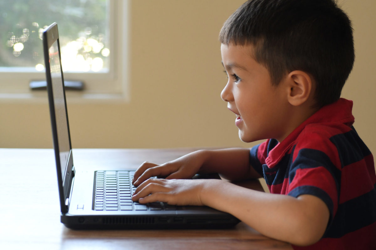 Kindergarten: Paul warms up for kindergarten by doing Typing Club.