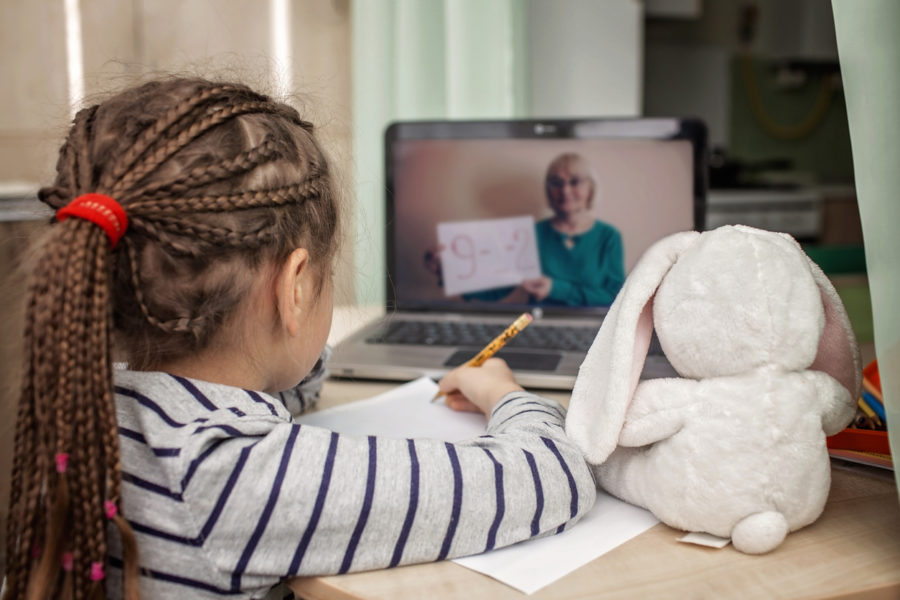 remote learning: girl at laptop