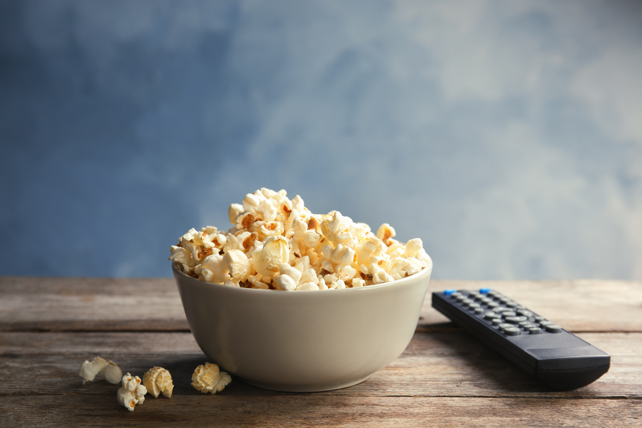 take a break: Bowl of popcorn and TV remote