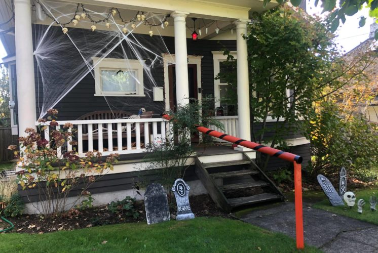 Trick-or-treating: Craftsman house with Halloween decorations and a candy chute