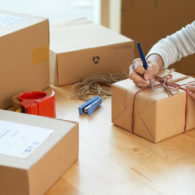 Shipping: woman preparing package for shipping