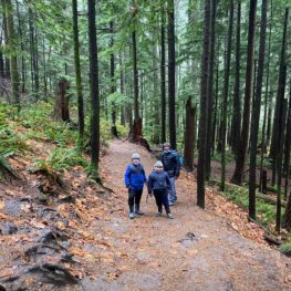 Father and sons on the trail in Olallie State Park