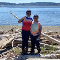 Boys standing at the Blake Island Beach
