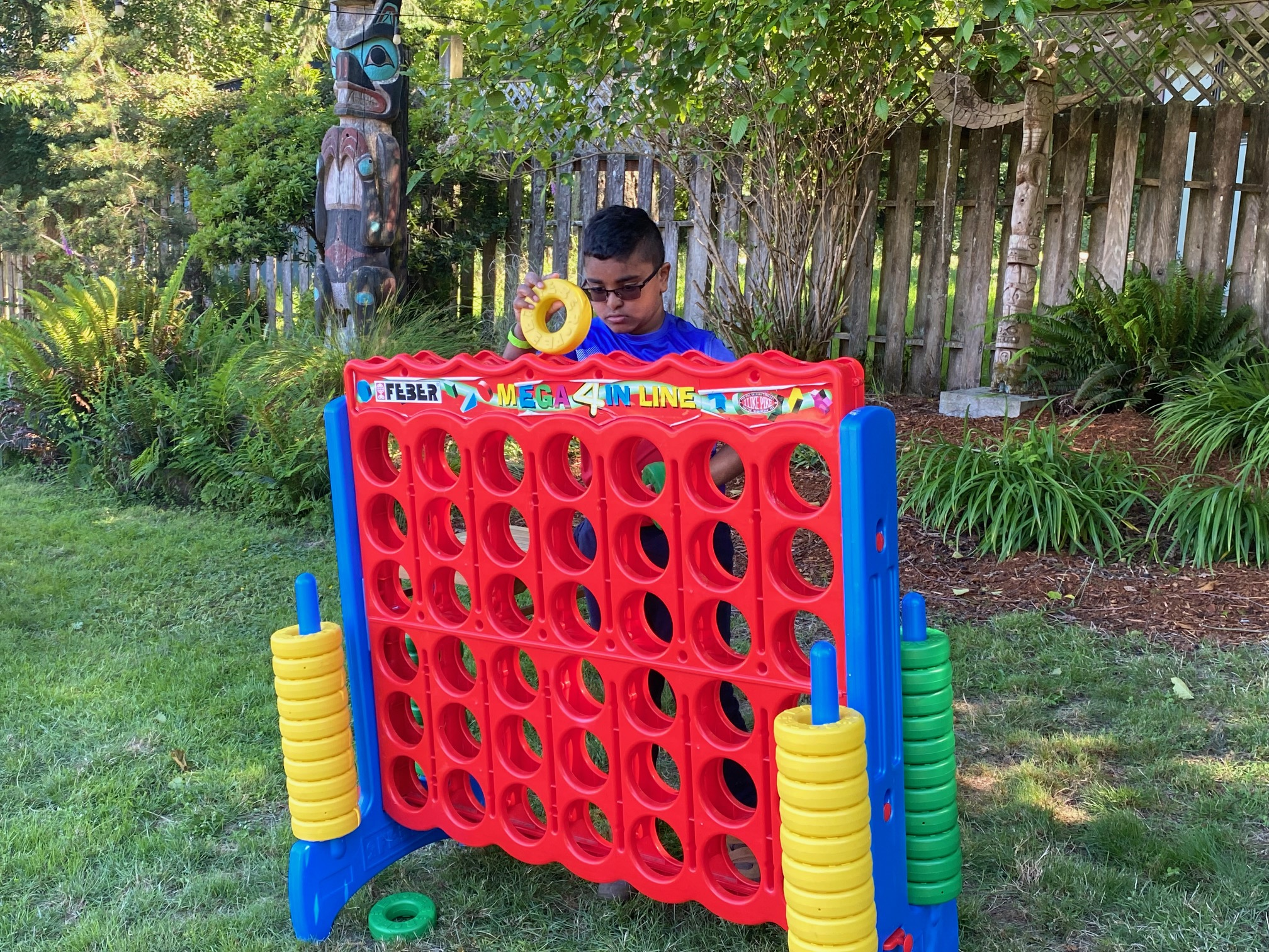 Child playing Connect Four
